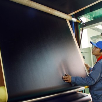 workers producing composition leather